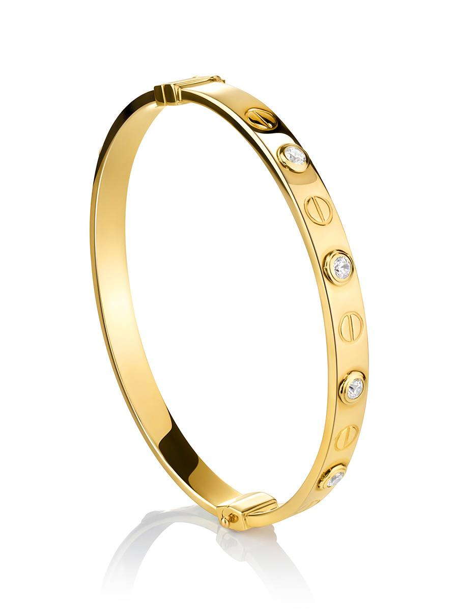 Лаконичный золотой браслет-обруч с кристаллами, фото
