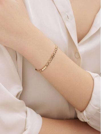 Эффектный золотой браслет из звеньев-сердечек, фото , изображение 4