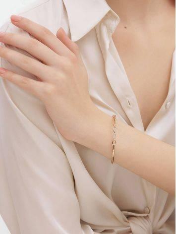 Жесткий золотой браслет с символом бесконечности, фото , изображение 4