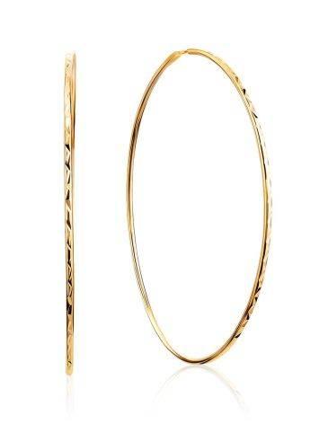 Золотые серьги-кольца с необычной текстурой, фото