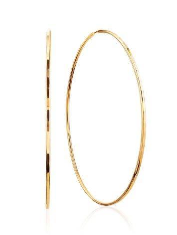 Потрясающие золотые серьги-кольца, фото