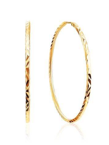 Стильные серьги-кольца из золота, фото