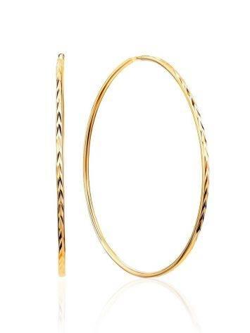 Нарядные золотые серьги-кольца, фото