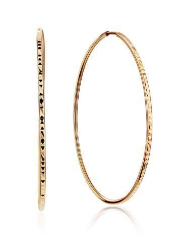 Яркие золотые серьги-кольца, фото