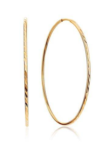 Стильные текстурные золотые серьги-кольца, фото