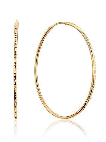 Необычные золотые серьги-кольца, фото