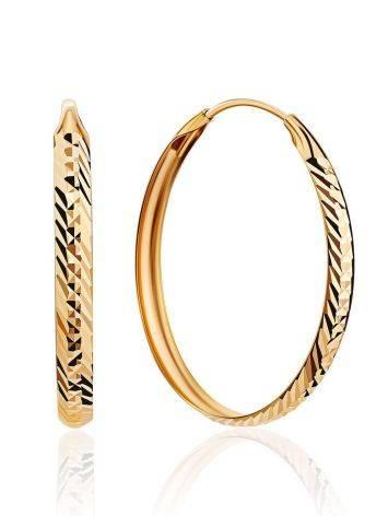 Эффектные золотые серьги-кольца, фото