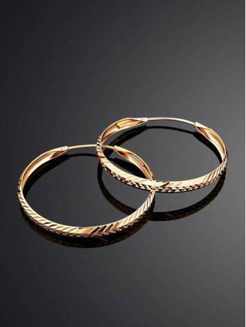 Эффектные золотые серьги-кольца, фото , изображение 2