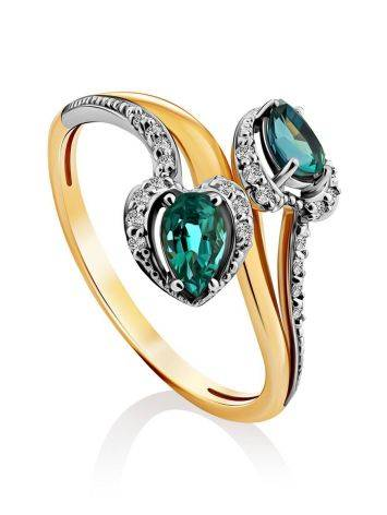 Шикарное золотое кольцо с 18 бриллиантами и 2 изумрудами, фото
