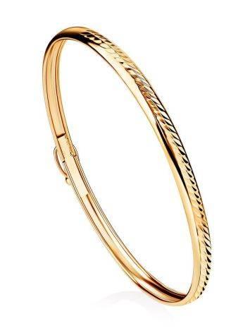 Лаконичный золотой браслет-обруч, фото