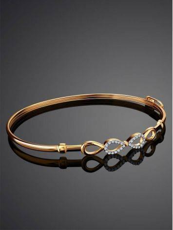Жесткий золотой браслет с символом бесконечности, фото , изображение 2