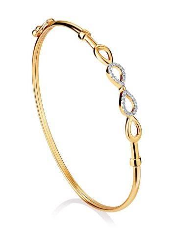 Жесткий золотой браслет с символом бесконечности, фото