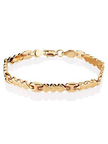 Эффектный золотой браслет из звеньев-сердечек, фото