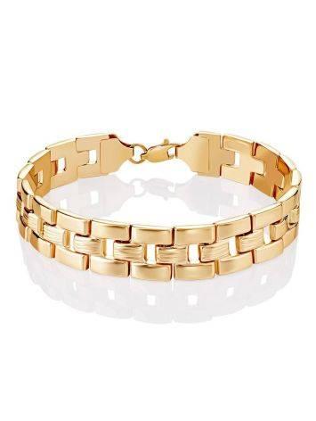 Шикарный золотой браслет из широких геометричных звеньев, фото