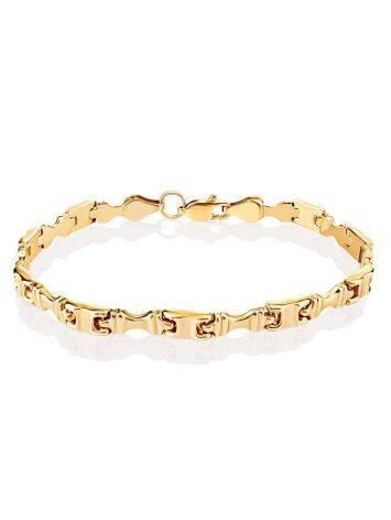 Стильный браслет из широких золотых звеньев, фото