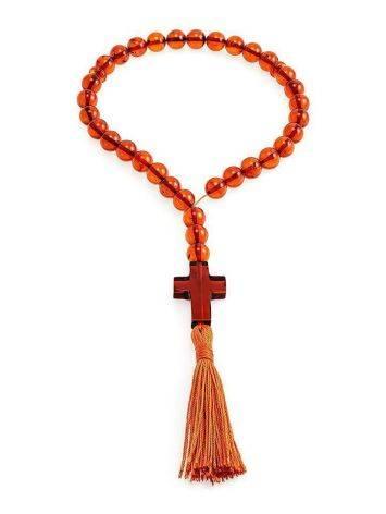 Православные чётки с 33 бусинами-шарами и резным крестом из натурального цельного янтаря коньячного цвета, фото