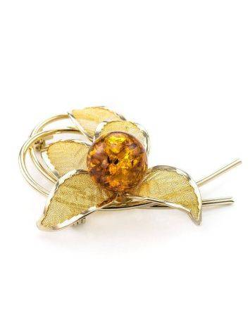 Нежная брошь в позолоте, украшенная янтарём вишнёвого цвета Beoluna, фото