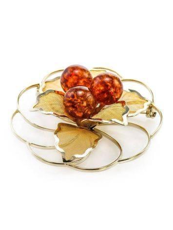 Позолоченная брошь круглой формы, украшенная натуральным коньячным янтарём Beoluna, фото