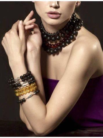 Замечательный стильный браслет из чёрного янтаря с фигуркой чертёнка «Куба», фото , изображение 2