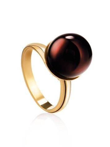 Яркое кольцо «Париж» из позолоченного серебра с круглой янтарной вставкой б/р, Размер кольца: б/р, фото