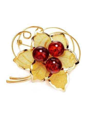 Брошь Beoluna, украшенная натуральным искрящимся янтарём вишнёвого цвета, фото