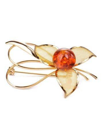 Красивая позолоченная брошь, украшенная натуральным балтийским вишнёвым янтарём Beoluna, фото