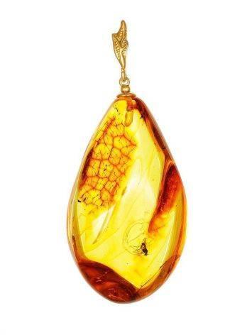 Подвеска из полупрозрачного золотистого янтаря с включением мухи, фото