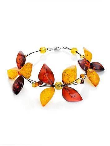 Нарядный браслет из натурального цельного янтаря на струне «Первоцвет», фото