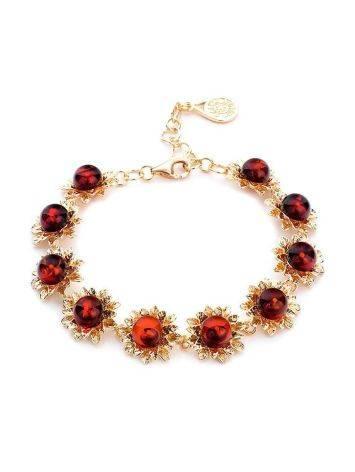 Нарядный позолоченный браслет с натуральным вишнёвым янтарём «Астра», фото