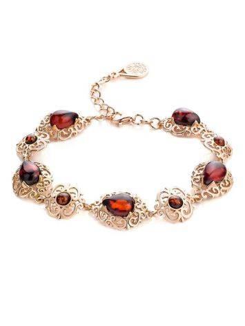Роскошный позолоченный браслет с натуральным вишнёвым янтарём «Луксор», фото