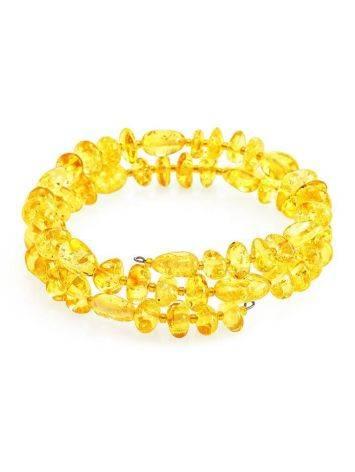 Яркий искрящийся браслет из натурального лимонного янтаря на струне, фото