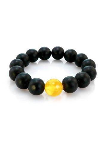 Яркий модный браслет из формованных янтарных шаров чёрного цвета «Куба», фото