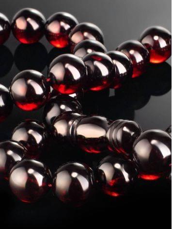 Крупные мусульманские чётки на 33 бусины-шара из формованного вишнёвого янтаря, фото , изображение 3