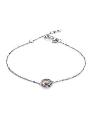 Тонкий серебряный браслет с бриллиантом и золотым элементом «Дива», фото